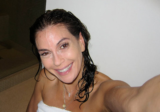Teri Hatcher smiles at the camera, sans makeup, in a picture posted on her Facebook fan page.