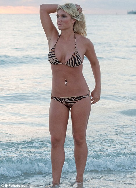 Brooke Hogan caught in a casual, completely spontaneous beach moment.
