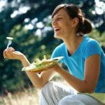 Women laughing alone (and on TV and in the movies) with salad