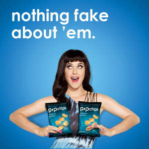 Ad for Pop Chips featuring Katy Perry holding bags of chips in front of her breasts.