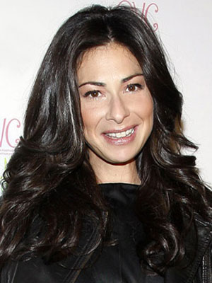 Headshot of Stacy London.
