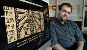 Mike Hoye stands beside his revamped, girl-friendly version of Zelda: Windwaker.