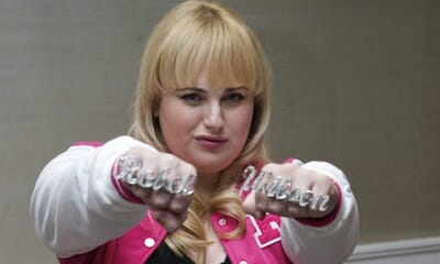 Photo of Rebel Wilson showing off her rings that spell out her name.