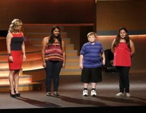 Image of The Biggest Loser child contestants on stage.