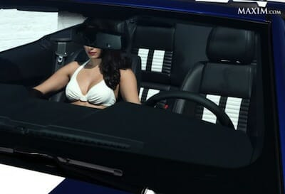 Image of faceless female model inside of car.