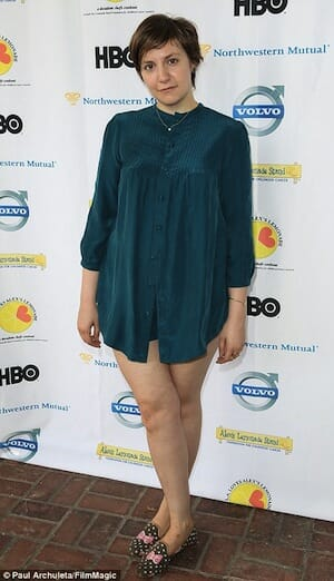 Photo of Lena Dunham in short dress, with legs exposed.