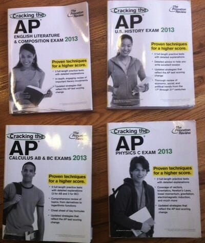 Image of 4 AP Exam books, girls featured on English and History while boys are on Calculus and Physics.