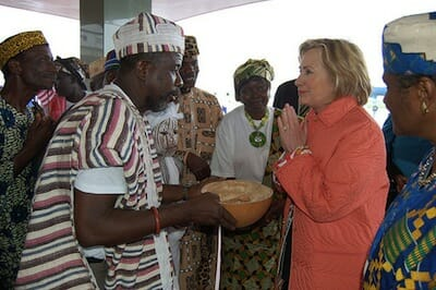 Photo of Hillary Clinton interacting with people in Liberia.