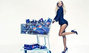 Image of Beyonce with shopping cart full of Pepsi.