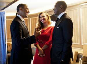 Candid photograph of Beyonce with President Obama and her husband, Jay-Z.