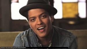 Photograph of Bruno Mars singing.