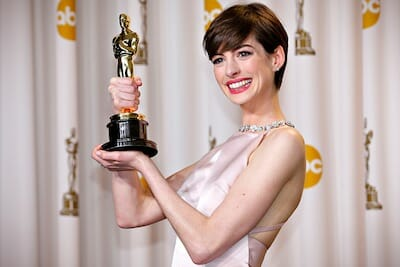 Photo of Anne Hathaway holding award.