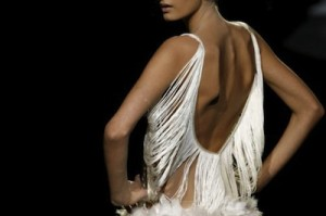 Photo of back of very thin model with shoulder blades and spine protruding.