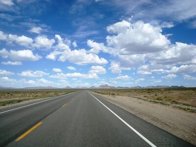 Photograph of open road and sky.