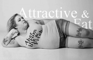 """Jes Baker posing in Abercrombie & Fitch shirt, with text """"Attractive and Fat"""" in background."""