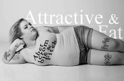 "Jes Baker posing in Abercrombie & Fitch shirt, with text ""Attractive and Fat"" in background."