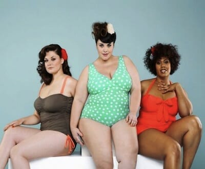 Three plus-size models in bathing suits.