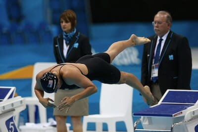 United States Olympic swimmer Kathleen Hersey takes off at the 2012 London games.
