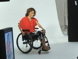 Angela Rockwood modeling in her wheelchair.