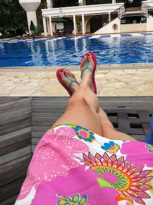 Legs by a pool.