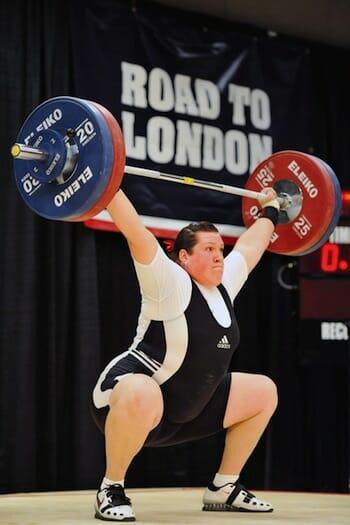 Olympian Sarah Robles lifting a huge weight.
