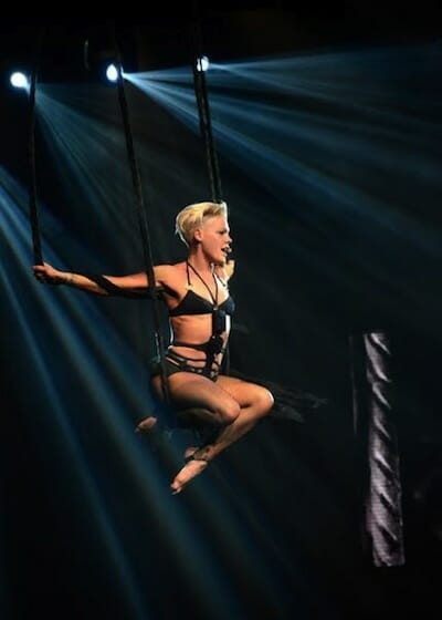 Pink doing acrobatic moves in a performance.