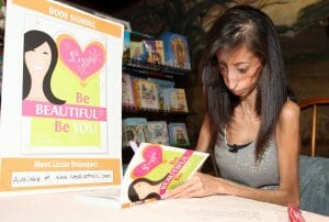 Lizzie signs one of her books