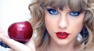 taylor swift holding red apple