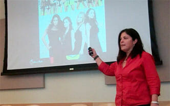 woman near PowerPoint with Pretty Little Liars on screen