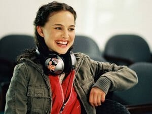 Natalie Portman with the classic MPDG oversized headphones and childlike smile.